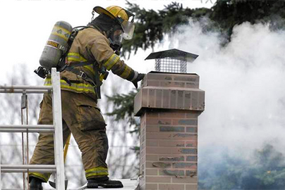 firefighter inspecting chimney fire