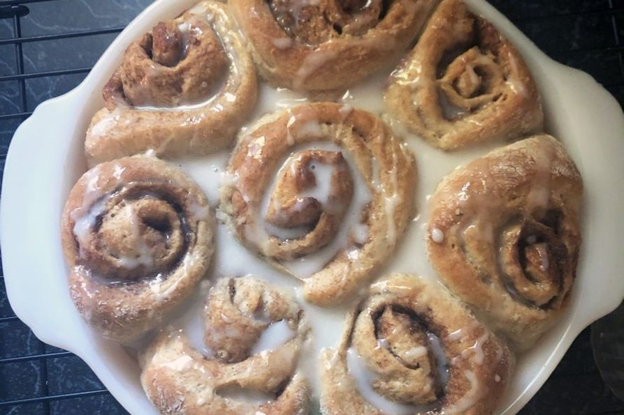 Glazed whole wheat cinnamon rolls in the pan.