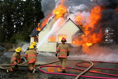 home fire with responding firefighters