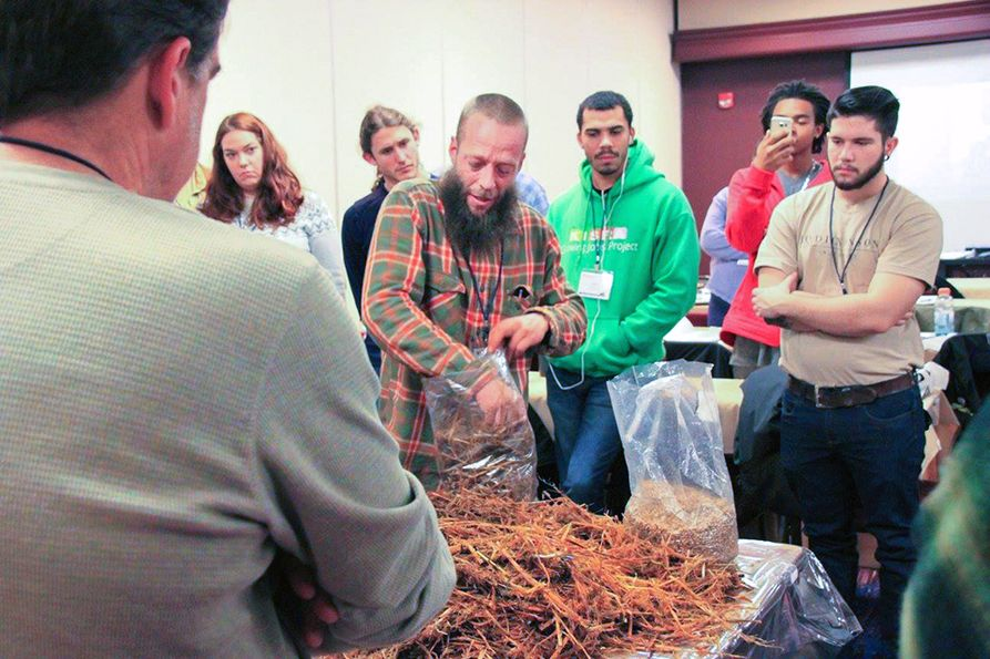 Hands-on learning about mushrooms with instructor and students at previous conference.
