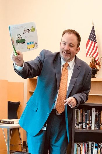 Mr. Alexander reads to children at Energy Express