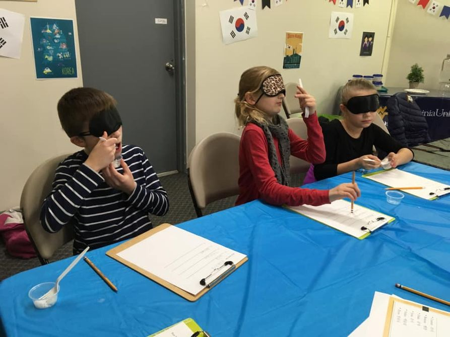 Youth Participate in Blind Taste Test of Different Rice