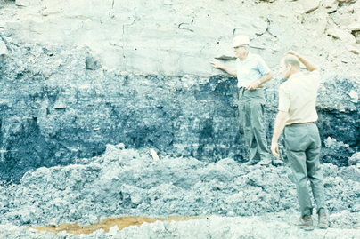 Two men examine the Smith-Bakerstown coal seam.