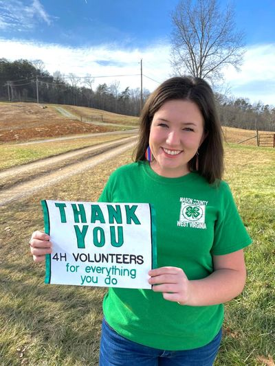 4-H member holding volunteer thank you note