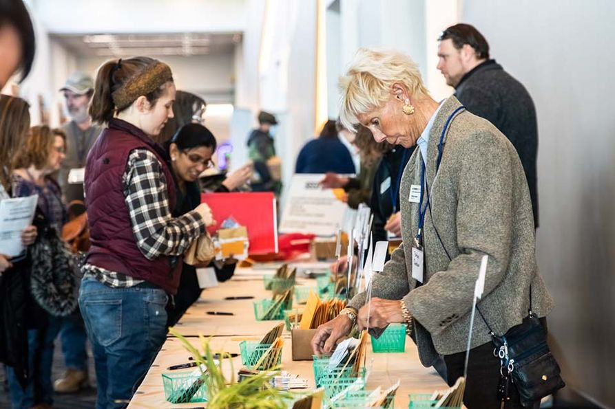 Conference goers at 2020 Small Farm Conference participate in a seed swap.