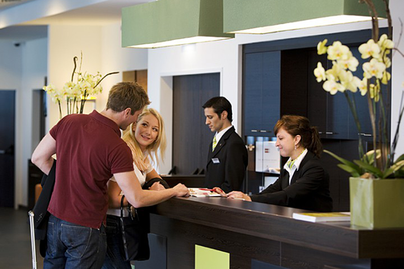 couple at hotel reception desk