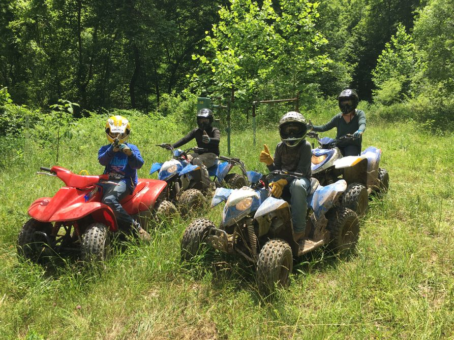 Four youths on ATVs participating in rider safety training.