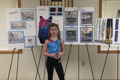 A 4-H youth presents on the topic of gymnastics