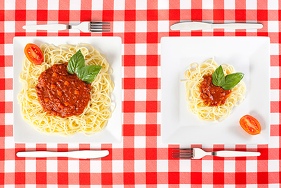 two portions of spaghetti in large and small