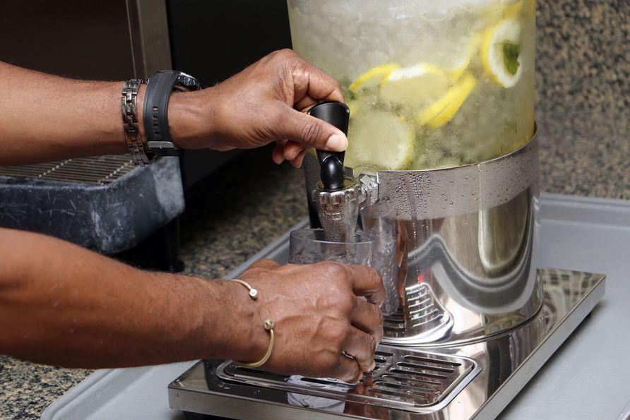 A veteran fills his cup with fruit-infused water at the Martinsburg VAMC.