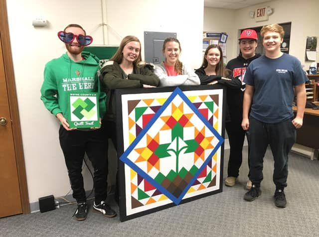 Teens Stand with Completed Quilt Block