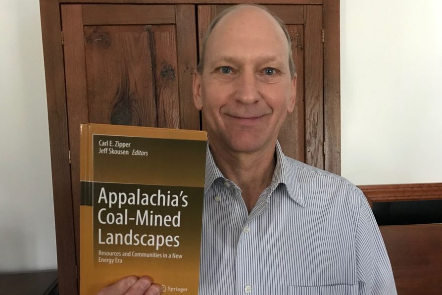 WVU Land Reclamation Specialist Jeff Skousen poses with new book.