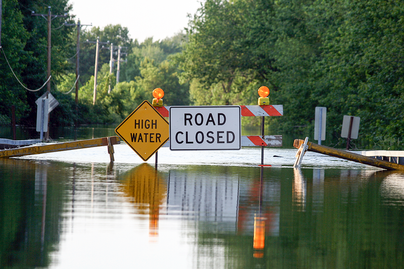 flooded street with road closed signage