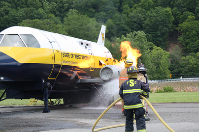 firefighters train putting out fire of aircraft