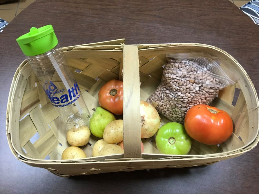 Basket of fresh foods and water bottle for McDowell residents