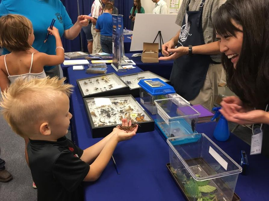 Children interact with exhibitors at WVU Building at State Fair