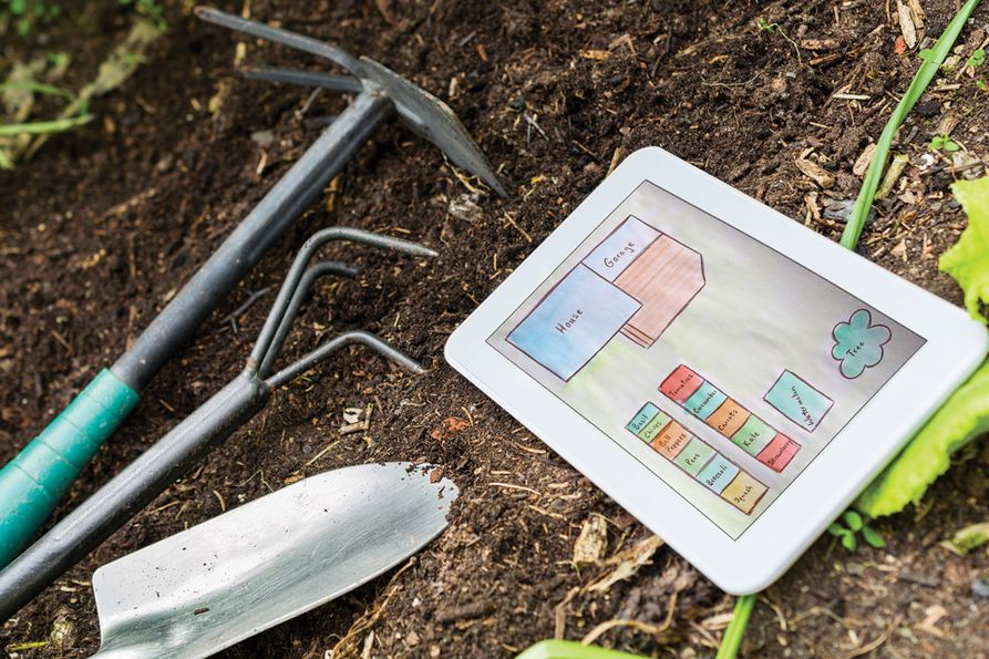 Garden site design with tools and tablet