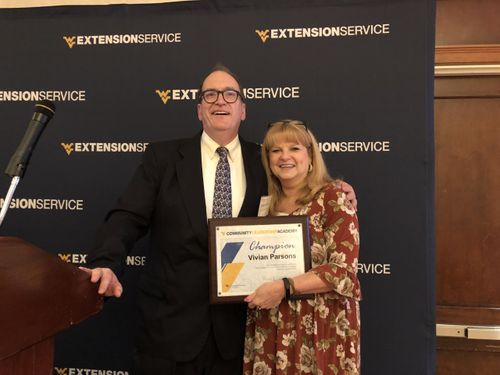 Community Leadership Academy Champion 2019 - Vivian Parsons with Mike Dougherty, 2019 Conference Chair