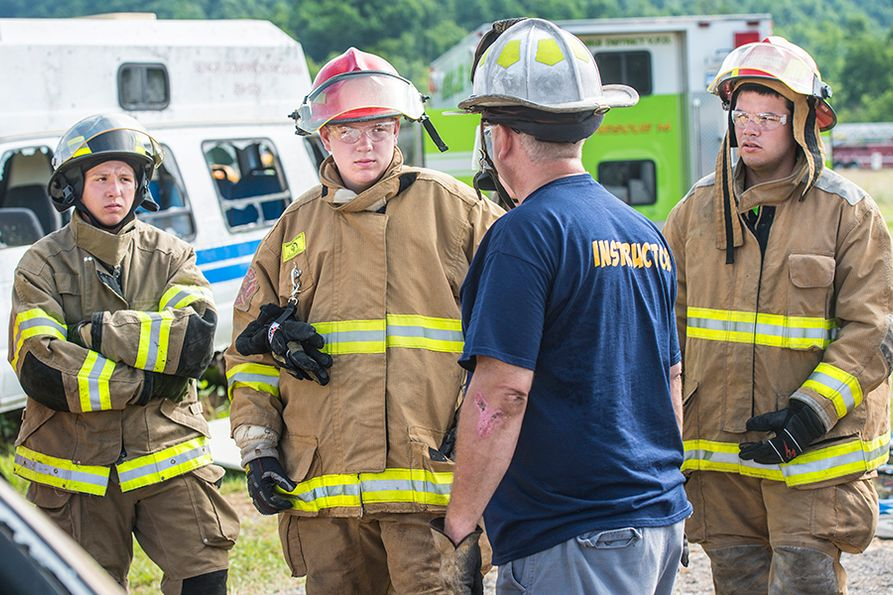 Instructor talks with group of junior firefighters