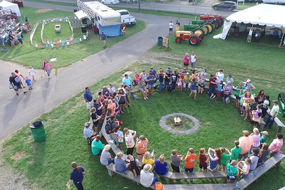 4-H'ers sitting around a council circle at the State Fair