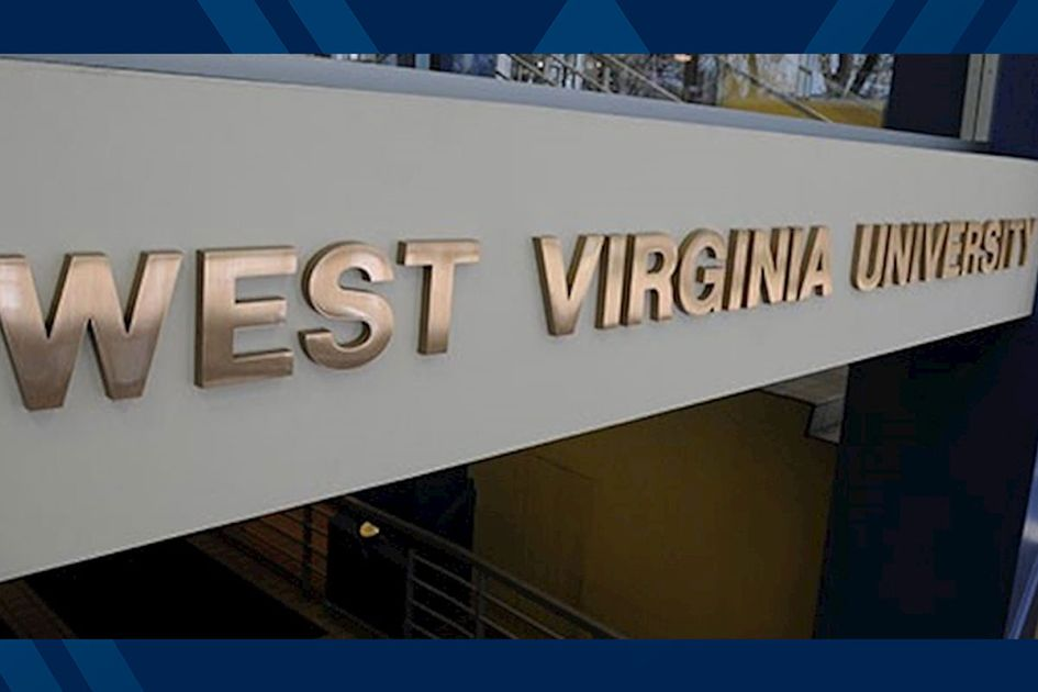 The words West Virginia University on a building in metal letters.