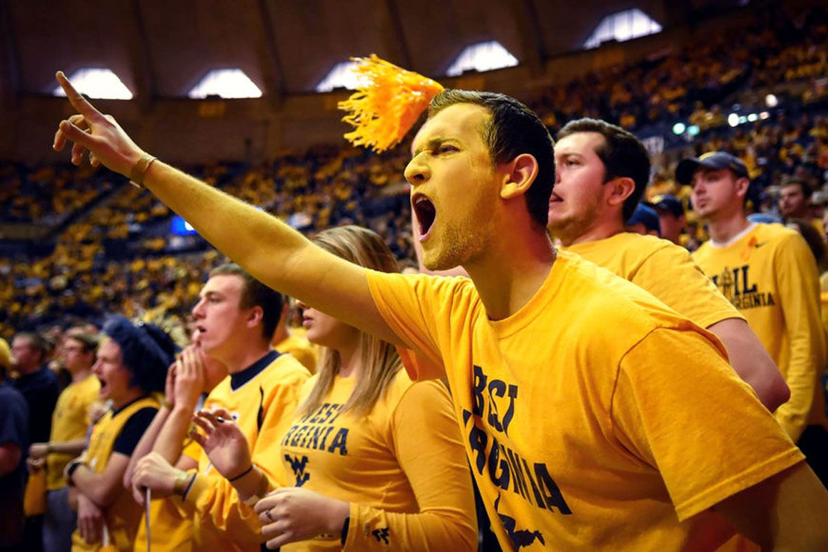 Mountaineer fans screaming in the stands.