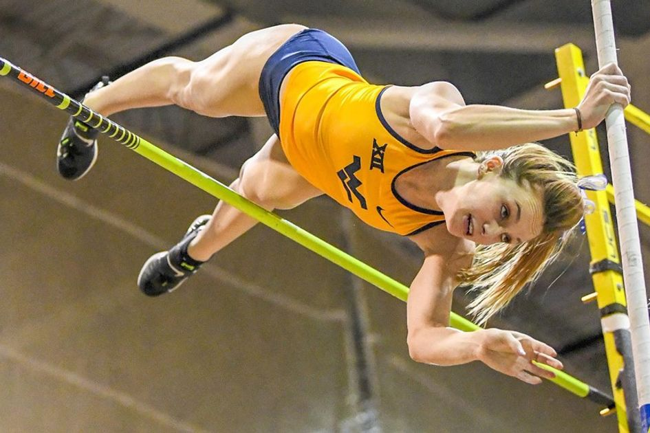 photo of a young woman pole vaulting