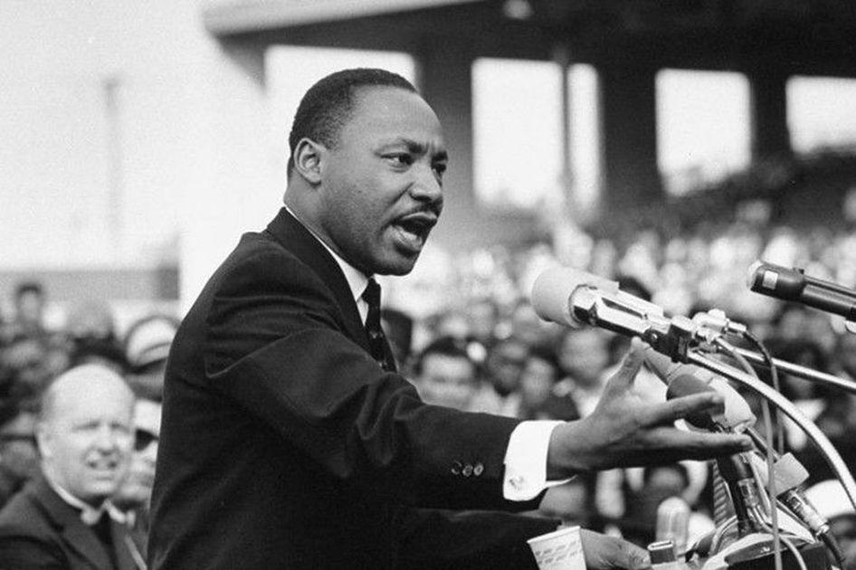 Martin Luther King Jr. speaking at podium.