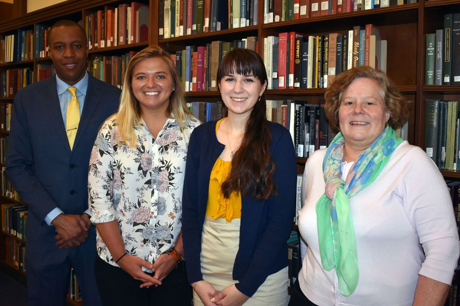 Munn Award winners Rachel A. Wattick (second from left) and Elizabeth Satterfield pose with Damien Clement, assistant dean of the Honors College, and Karen Diaz, interim dean of WVU Libraries.