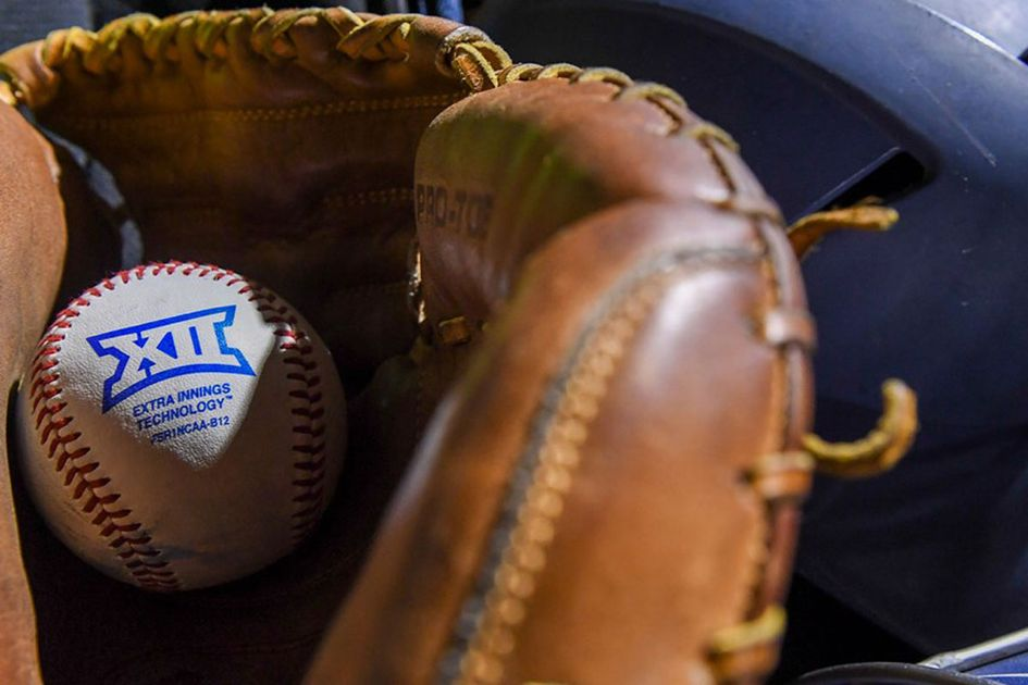 A baseball glove holding a ball with the Big 12 logo on it.