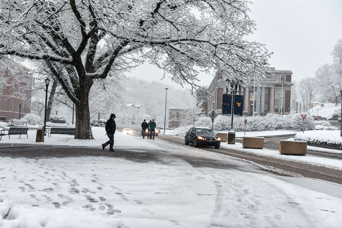 Students walk on snow covered WVU campus in Morgantown.