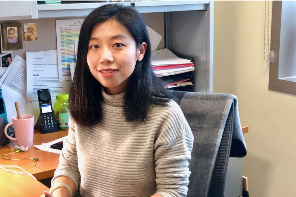 Researcher Shan Jiang sitting at her desk.