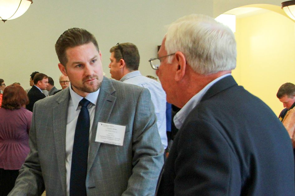 Two men in discussion at WVU Extension Service Community Leadership Academy