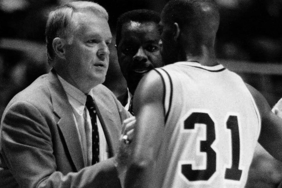 Black and white photo of WVU basketball players and coach.