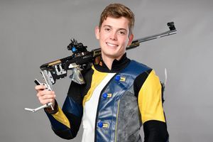 man posing with air rifle