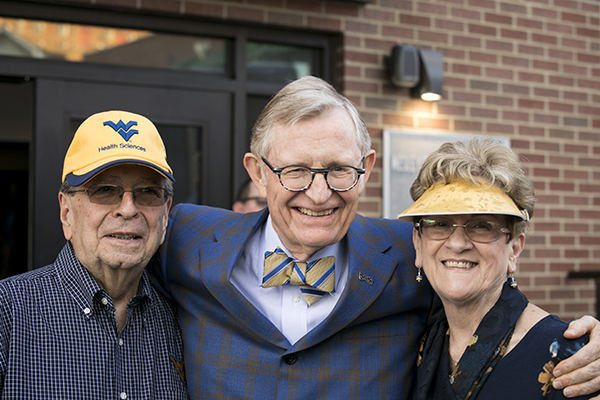 President Gee with Homecoming Award recipients in WVU head gear