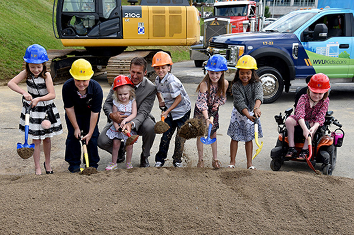 A group of young children breaking ground at the WVU Childrens hospital site.