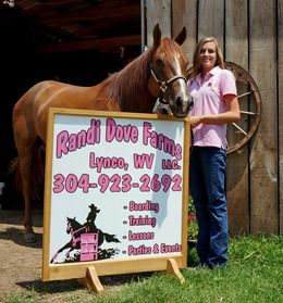 image of Randi and horse in front of sign