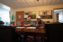 Image of student getting tutoring from one of Collegiate Recovery's staff members.