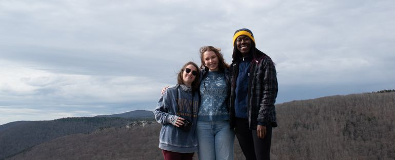 Image of three women posing during a hike.