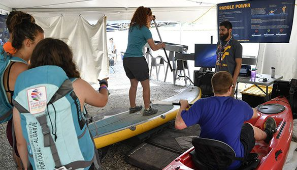 Scouts view the Science Behind the Sport booth at the Scouts World Jamboree in Beckley, WV.