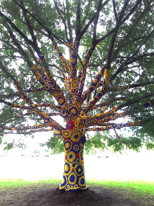 """Yarn bombing"" of the tree outside the Creative Arts Center"