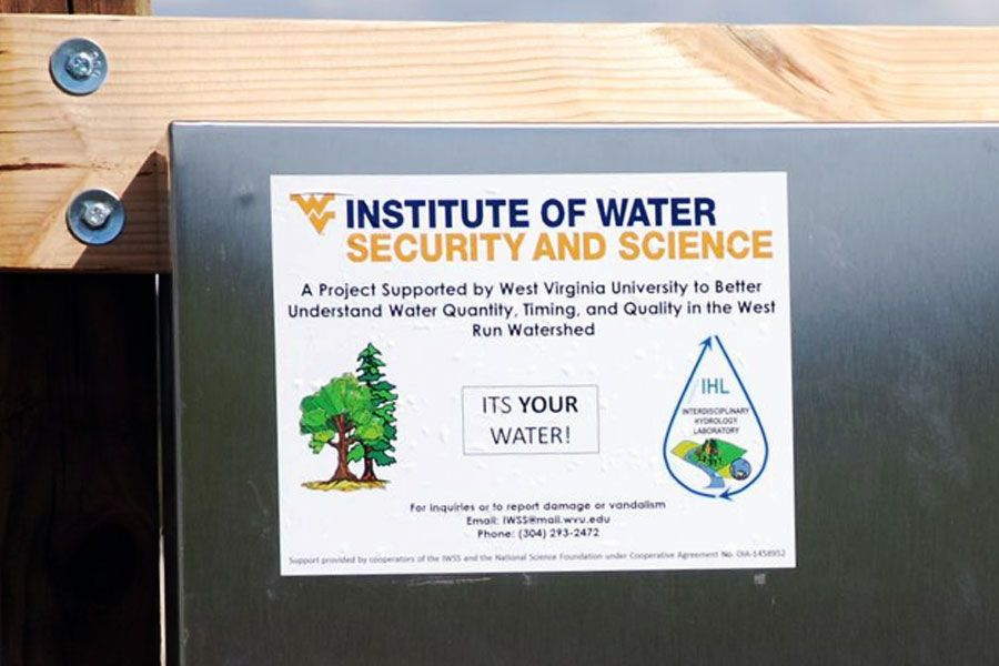 "Institute of Water Security and Science sticker that reads ""A project supported by WVU to better understand water quality, timing, and quality in the West Run Watershed"""