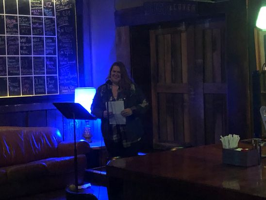 Katie reading at 123 Pleasant Street.