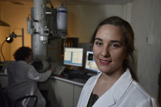 Portrait of Maria TorresArango in the lab with Marcela in the background