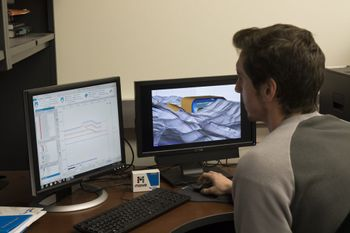 Student uses Schlumberger software