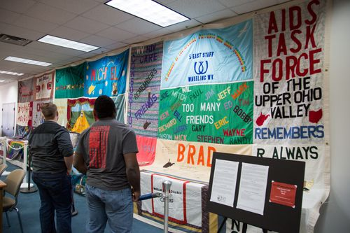 WVU Tech students view three pieces of the NAMES Project Memorial AIDS Quilt in the library.