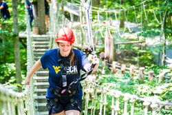WVU Tech student Jessica Beck crosses a rope bridge during Tech Adventures.