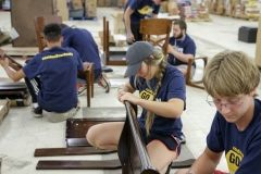 students assembling furniture