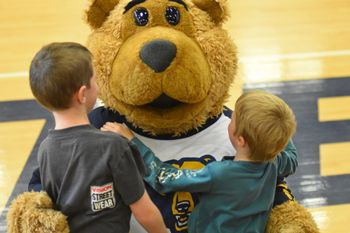 Monty mingle with attendees at the Homecoming basketball game.